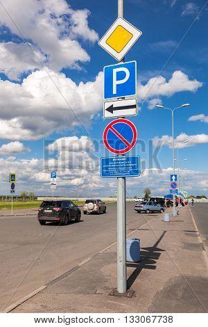 SAMARA RUSSIA - MAY 22 2016: Traffic signs at the car parking in the terminal Samara Kurumoch Airport in summer sunny day