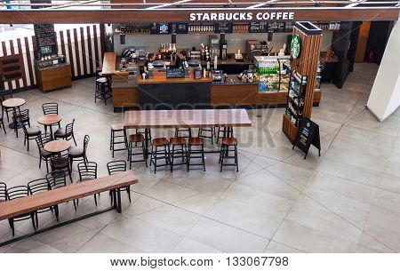 SAMARA RUSSIA - MAY 22 2016: Starbucks cafe in Samara Kurumoch airport. Starbucks Corporation is an American global coffee company and coffeehouse chain