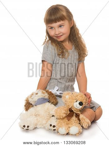 Beautiful little blonde girl with wavy , long, blond hair and short bangs on the head playing soft toys - Isolated on white background