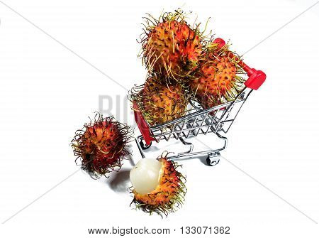 Rambutan is in a shopping trolley on an isolated white background. (Thai Fruits)