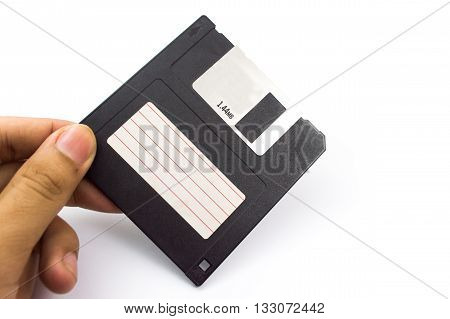 Floppy Disk  In Hand Isolated On White Background.