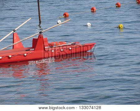 Rowed rescue catamaran at sea waiting for emergency. Tuscany Italy