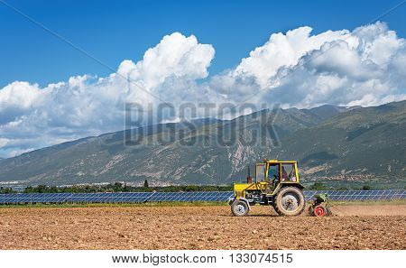 Tractor working in the field. Time of sowing.