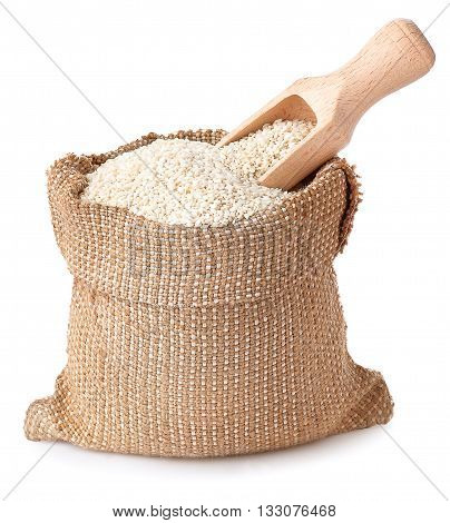 sesame seeds with wooden scoop in sack isolated on white background. Full burlap bag with sesame seeds. Sesame seeds