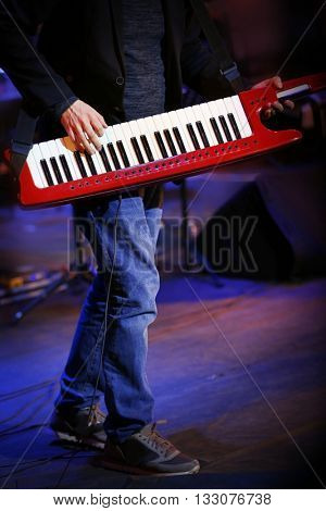 Musician playing synthesizer at concert