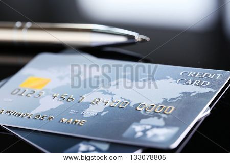 Credit cards with glasses, close up