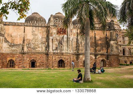 Delhi, India - March 26, 2016: Unidentified man meditate in Lodhi Gardens in New Delhi, India.