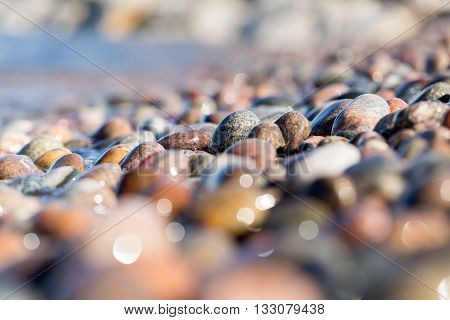 Colorful beach stones cover the shoreline of Crisp Point Beach on the edge of Lake Superior in the Upper Peninsula of Michigan