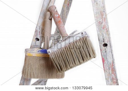 dirty brushes of the ladder hanging from the painter's color