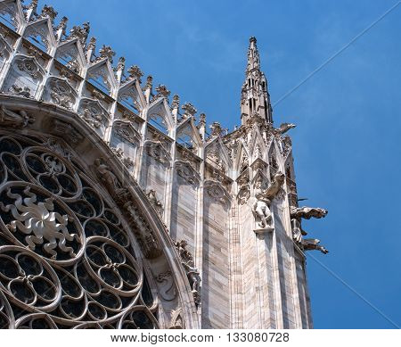 Milan Italy - May 25 2016: White Spiers against the blue sky on the roof of the Duomo.