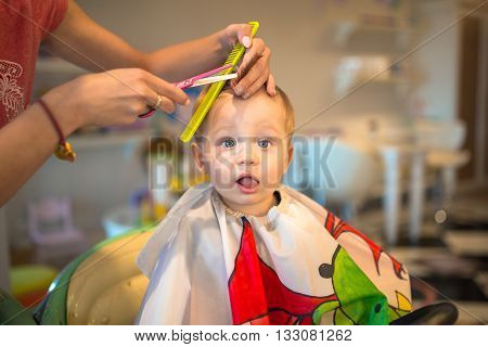 First haircut of one years old toddler