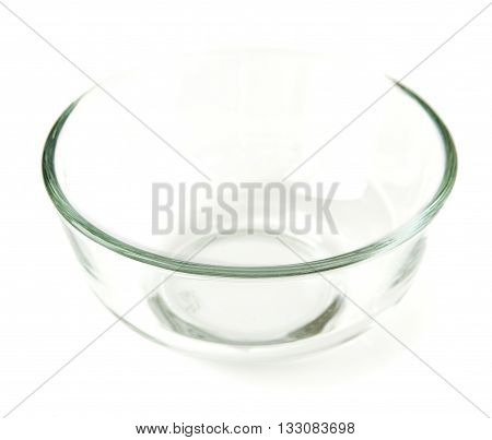 Empty the bowl of glass, isolated on a white background closeup
