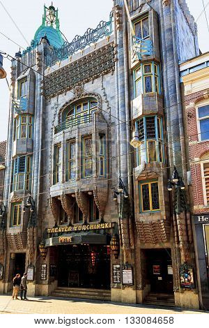 AMSTERDAM, NETHERLANDS - MAY 5, 2013: It's an architectural landmark of the city - a building Theater Tuschinski presenting an eclectic mix of different styles (Amsterdam School Jugendstil Art Nouveau and Art Deco).