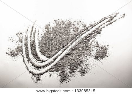 Wave wind abstract tracery shape drawing in chaos ash dust pile