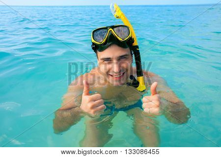 men in blue clear ocean wearing yellow diving mask