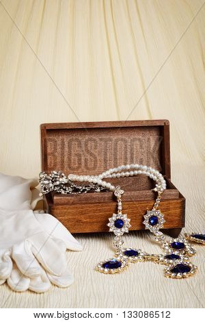 closeup antique wood jewellery box and gloves