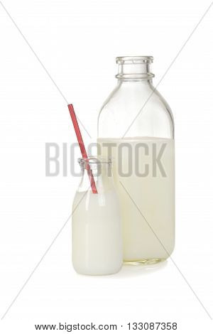 glass and bottle of milk on white