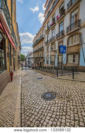Lisbon Portugal-April 12 2015:narrow old cobble stone street in old town of lisbon