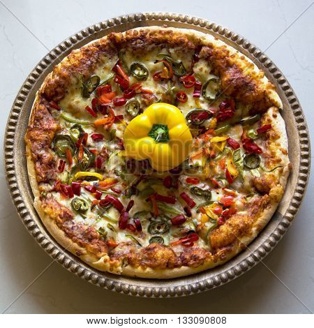 A Large Pizza with Bell Peppers and Jalapeños
