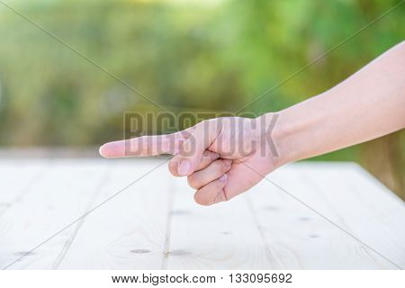 Hand of Woman showing one sign over green background