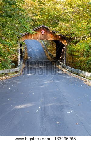 Pierce Stocking Drive Covered Bridge is nestled among autumn tinged trees as this scenic drive wends its way through Sleeping Bear Dunes in northern Michigan