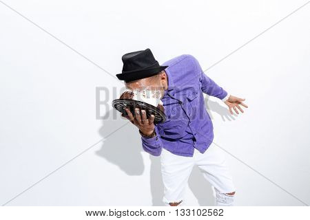 Silly man has pie all over his face isolated on the white background