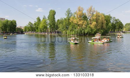Moscow - May 9 2016: Lots of happy people relax and ride on catamarans in the summer in Gorky Park May 9 2016 Moscow Russia