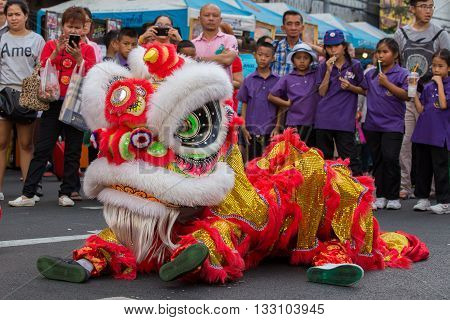 BANGKOK THAILAND - FEBRUARY 09 2016 : Dragon dance performers work the street of Yaowarat during the celebration Chinese New Year and Valentine's Day. Yaowarat is a Chinatown situated in Bangkok.
