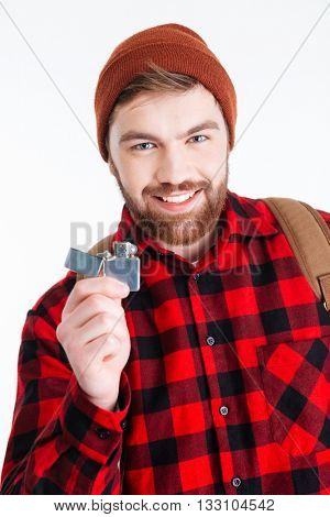 Happy hipster man holding gas lighter and looking at camera