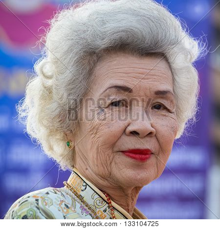 BANGKOK THAILAND - FEBRUARY 09 2016 : Unknown Thai old woman during the celebration of Chinese New Year and Valentine's Day in Yaowarat street Chinatown