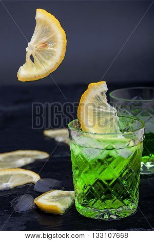 lemonade from lemon and tarragon on black background