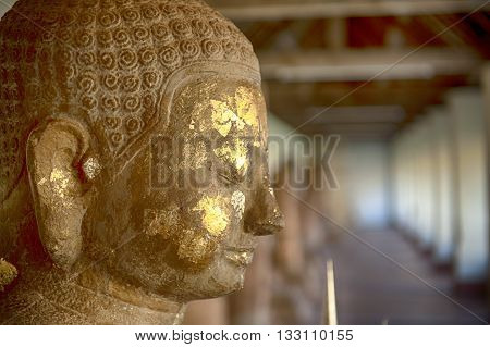 Buddha image at Wat Phra That Luang landmark of Lao PDR in Vientiane