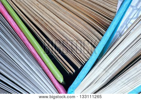 Old and used colorful hardback books or text books seen from above. Back to school.