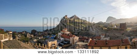 Coastal town view from the sea, mountain landscape.