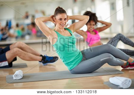 Young brunette on fitness training at gym
