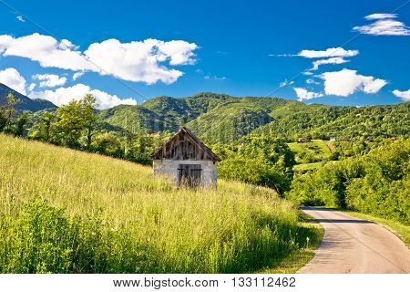 Landscape of green Zumberak hills with old stone cottage northern Croatia