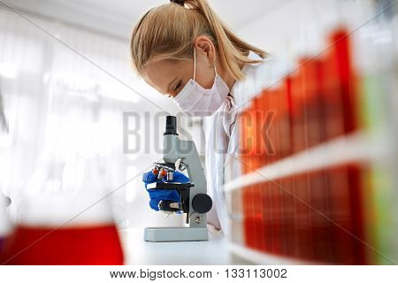 Microscope laboratory - woman medical research chemist experiment