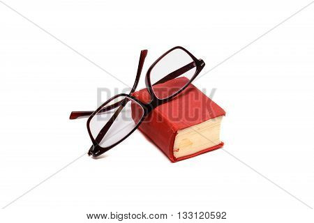 Pocket dictionary book and glasses isolated over white background