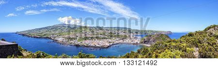 View of the town of with the bay on the background of green hills and blue sky to the Azores