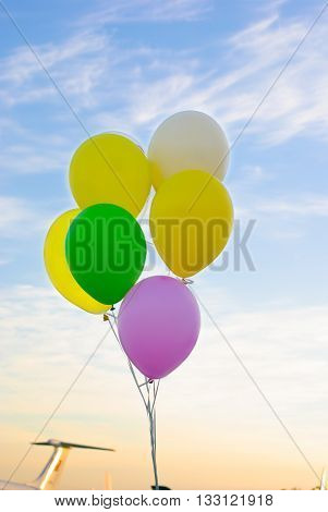 colored balloons on a background of blue sky