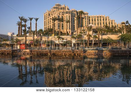 Eilat, Israel - may 09, 2015: Modern hotel in Eilat , reflected in the waters of the canal, at sunset