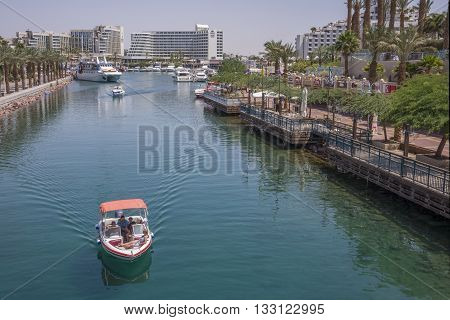 Eilat, Israel - may 09, 2015: A speedboat sailing the waterways of the Port of Eilat