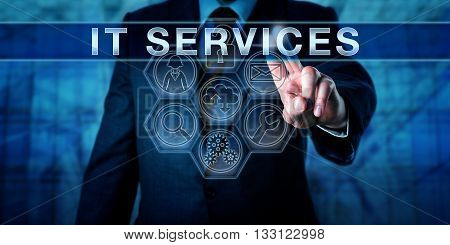 Engineer is pressing IT SERVICES on an interactive touch screen. Business metaphor and information technology concept for a workflow-driven and process-oriented approach to delivery of IT services.