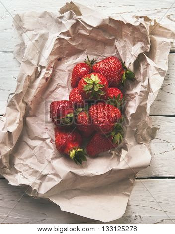 Red Fresh strawberry on the rustic style wooden table