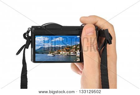 Hand with camera and Village Perast - Montenegro image (my photo) isolated on white background