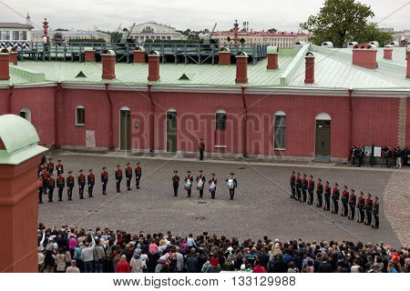 ST. PETERSBURG, RUSSIA - MAY 28, 2016: People watching honor guard ceremony in St. Peter and Paul fortress. The ceremony was held since the foundation of fortress till 1926, and re-established in 2008