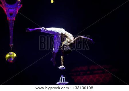 ST. PETERSBURG, RUSSIA - JUNE 2, 2016: Equilibrist Papin Khachatryan in the dress rehearsal of the Show of Water, Fire, And Light in the Ciniselli circus. This new show first time arrived in the city