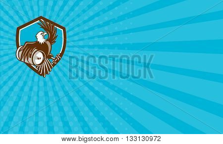 Business card showing illustration of an american bald eagle carrying beer keg viewed from the side set inside shield crest on isolated background done in retro style.