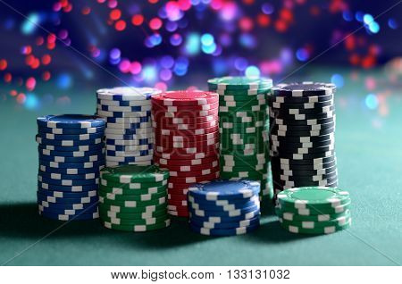 Stack of poker chips on a green table. Poker game theme