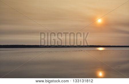 Colorful sunrise on a lake that is in Saskatchewan Canada